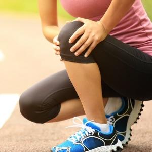 Athlete holding painful knee