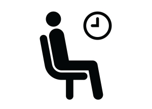 A black and white cartoon of a stick person sitting in a chair with a clock on the wall.