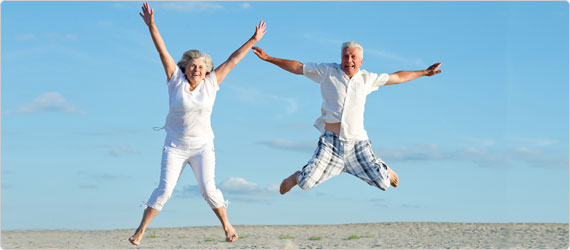 A picture of two pensioners star jumping.