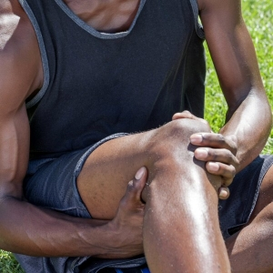 Athlete clutching painful knee